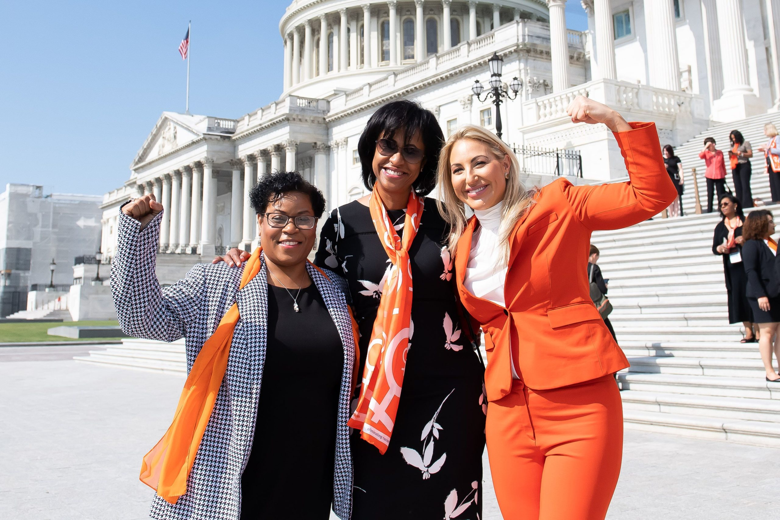 three women from YWCA USA stand in front of the Capitol Building