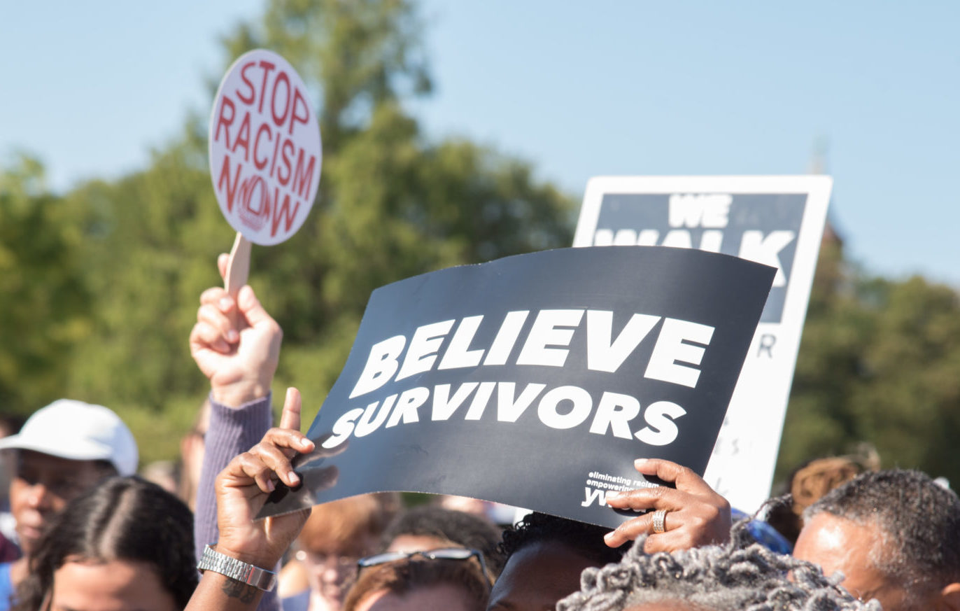 believe survivors sign at march
